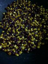 Mixing Corn Kernels with Spices for Popcorn